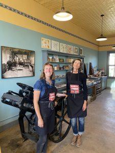 Rosie Carter and Jamie Karolich standing inside the Mancos Common Press